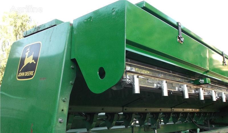 καινούρια σπαρτική μηχανή JOHN DEERE για σπαρτική μηχανή  Prisposoblenie dlya vneseniya udobreniy
