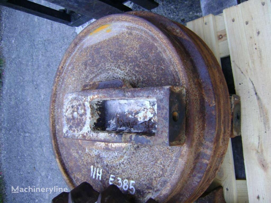 εκσκαφέας NEW HOLLAND E 385 για ανταλλακτικό Idler Wheel NEW HOLLAND